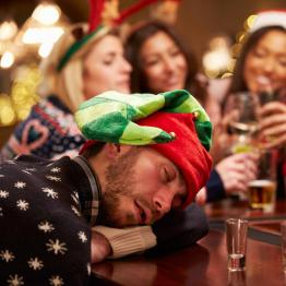 Man drunk and asleep Christmas party